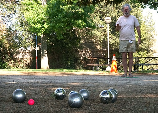 A pétanque player works on his toss
