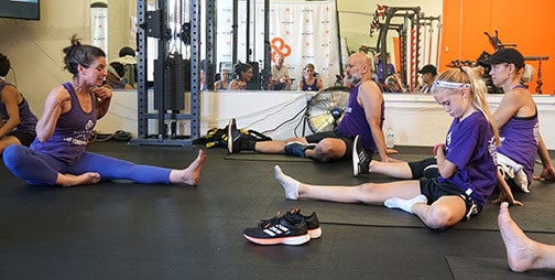 Gym-goers work on their exercise routines